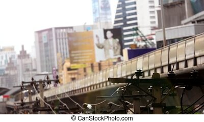 Sky train in Bangkok with business building