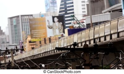 Sky train in Bangkok with business building.