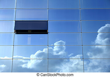 Sky Window - Sky and clouds reflected in glass building with...