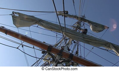 Sky with a ship's sail - A worms eye view shot of a ship's...