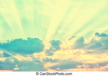 Sky with sun rays through the clouds