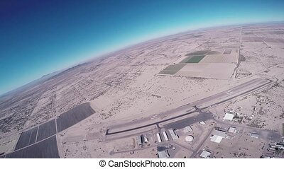 Skydiver fly on parachute above Arizona. Sunny. Extreme...