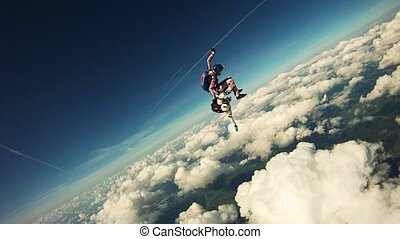 Skydiver freestyle in in cloudy sky. Extreme sport....