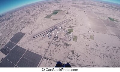 Skydiver parachuting above Arizona. Flight. Sunny day....