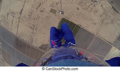 Skydiver parachuting above arizona. Horizon. Adrenaline....