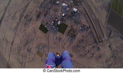 Skydiver parachuting above sands of arizona. Horizon....