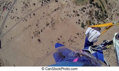 Skydiver parachuting in above arizona. Scenery. Adrenaline....