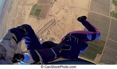 Skydiver parachuting in blue sky. Scenery. Adrenaline. Above...