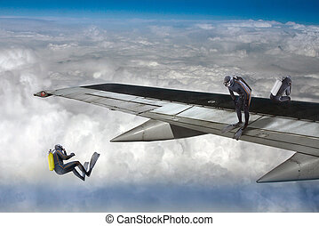 Skydiver - Skydivers jumping from an airplane wing....
