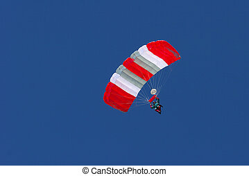 Skydiver - skydiver floating on the wind as he steers...