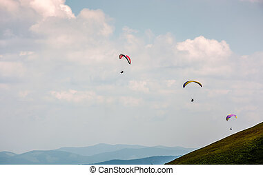 Skydiving extreme over the mountains - Skydivers fly over...