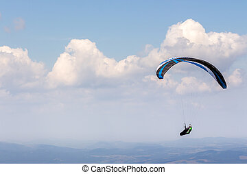 Skydiving extreme over the mountains - Skydiving flying over...