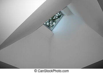 Skylight - Geometric ceiling with skylight in modern home