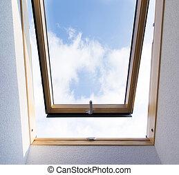 Skylight window - Beautiful blue sky view through roof...