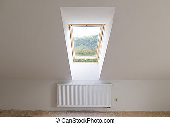 Skylight window - Empty unfinished new room with mansard...