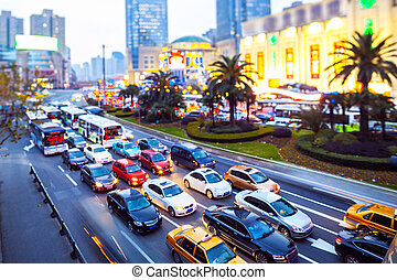 skyline and busy traffic trails in modern city street