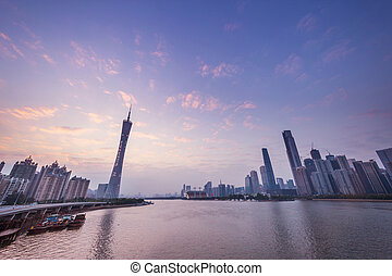 skyline and cityscape of modern city guangzhou during sunset...