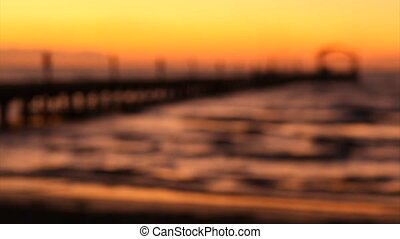 Skyline and pontoon at sunset - In and out of focus,...