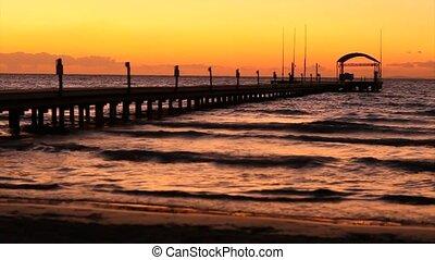 Skyline and pontoon at sunset - Timelapse. Beautiful warm...