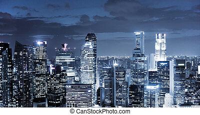 skyline at night - panoramic view of illuminated skyscrapers...