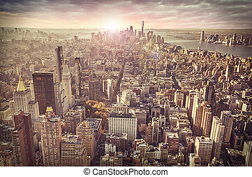 skyline ny york city, solopgang, ind, baggrund.
