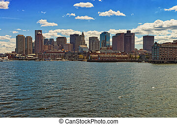 Skyline of Boston behind the river Charles
