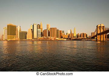 Skyline of buildings at Wall Street, Downtown Manhattan and Brooklyn Bridge, Manhattan, New York City, NY, USA