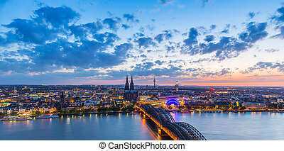 skyline of cologne city at sunset
