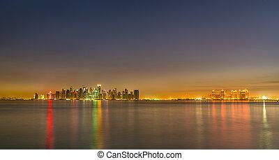 Skyline of Doha at night. The capital of Qatar