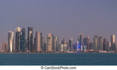 Skyline of Doha night to day transition timelapse in Qatar