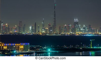 Skyline of Downtown Dubai at night timelapse.