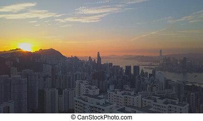 Skyline of Hong Kong at sunset. (aerial view)