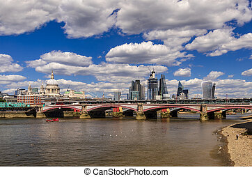 Skyline of London buildings and bridges over the Thames