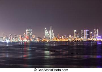 Manama City skyline illuminated at night. Kingdom of Bahrain, Middle East