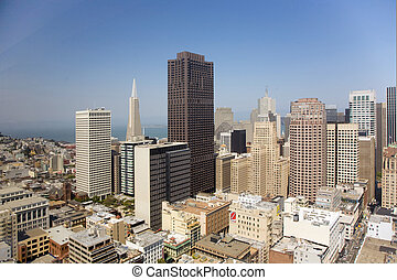 Skyline of San Francisco seen from a sky scraper with blue...