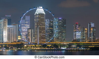 Skyline of Singapore with famous Singapore Ferries Wheel at...