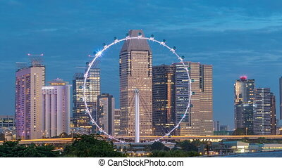 Skyline of Singapore with famous Singapore Ferries Wheel night to day timelapse
