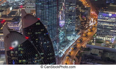 Skyline of the buildings of Sheikh Zayed Road and DIFC aerial night timelapse in Dubai, UAE.
