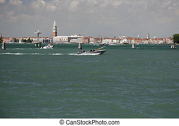 Skyline of Venice, Italy - boat in front