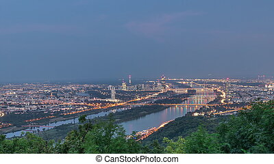 Skyline of Vienna from Danube Viewpoint Leopoldsberg aerial day to night timelapse.