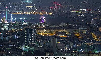 Skyline of Vienna from Danube Viewpoint Leopoldsberg aerial night timelapse.