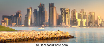 The skyline of West Bay and stony bank view from Museum of islamic art aduring sunset Doha, Qatar