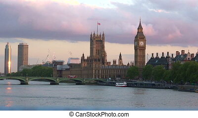 Skyline of Westminster bridge and Palace with Big Ben Clock Tower on sunset London UK.The palace is one of the most prominent symbols of London and the United Kingdom.