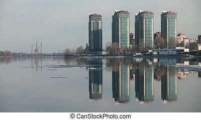 Skyline skyscrapers reflected in the water