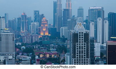 skyline Time lapse at day to night in Kuala Lumpur City Center. pan up