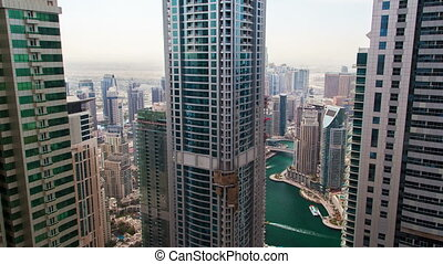 Skyline time lapse of Dubai Marina. pan up