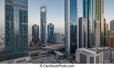 Skyline view of the buildings of Sheikh Zayed Road and DIFC day to night transition timelapse in Dubai, UAE. Skyscrapers in financial centre aerial view from above after sunset