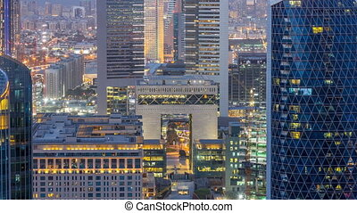 Skyline view of the buildings of Sheikh Zayed Road and DIFC day to night timelapse in Dubai, UAE.