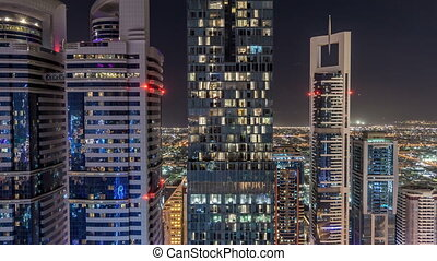 Skyline view of the buildings of Sheikh Zayed Road and DIFC night timelapse in Dubai, UAE.