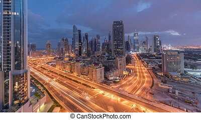 Skyline view of the buildings of Sheikh Zayed Road and DIFC night to day timelapse in Dubai, UAE.